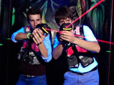 Teens playing laser tag