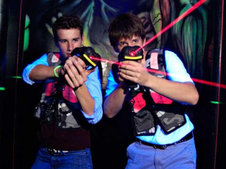 Teens playing laser tag