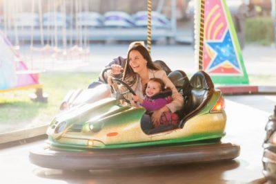 Mom & daughter in bumper car