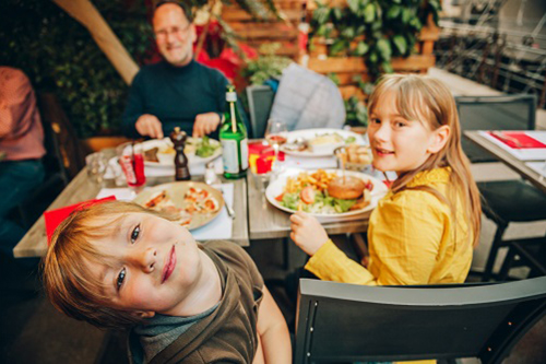 Kids enjoying a delicious meal