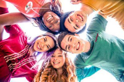 Five teens looking down at camera