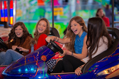 Young ladies on bumper cars