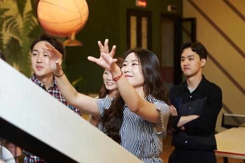 Group playing basketball arcade game