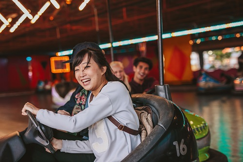 Young lady rides bumper cars