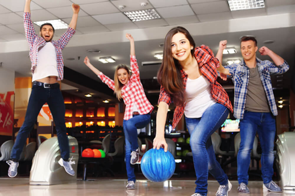 Young adults bowling.