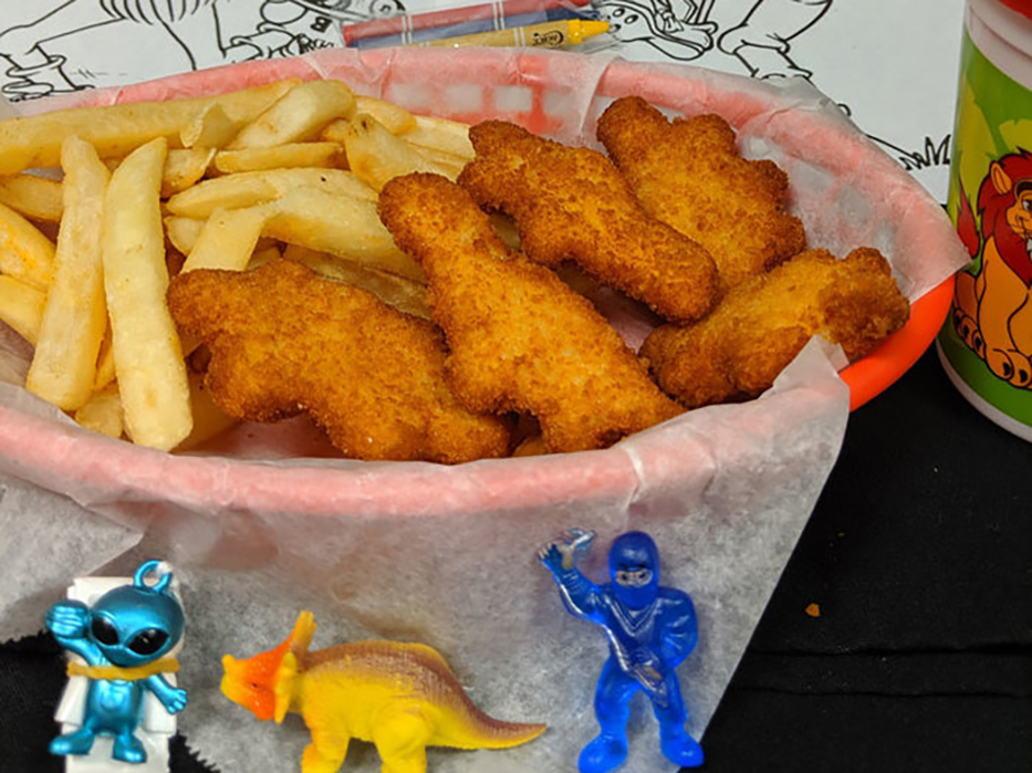 kids meal with chicken nuggets and fries and prize