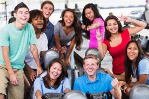 Group posed photo near go karts.