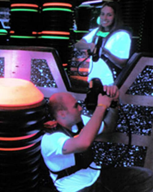 Attractions | couple playing laser tag