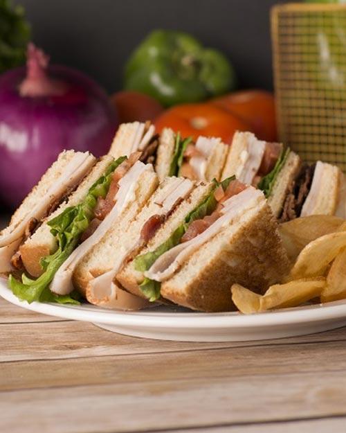 Food & Drink - Turkey Club Sandwich with chips