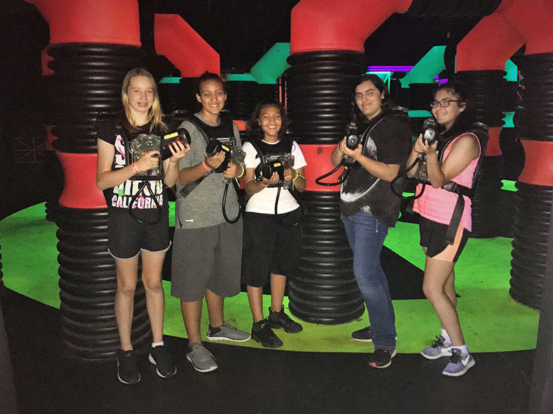5 teens geared up for laser tag
